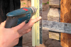 Drill in men hand. Build house Royalty Free Stock Photos