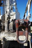 Drill pipe swivel attached to drill pipe. Drill swivel attached to drill pipe. Focus is on attached swivel Stock Photos