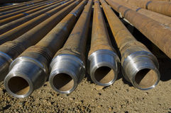 Drill pipes. Over brown ground stock photography