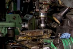Drill Press is a drill that attaches to a stand or table. royalty free stock photography