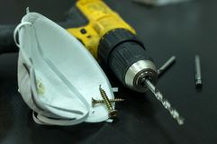 Drill, respirator, mask, working tools and screws Royalty Free Stock Images
