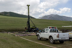 Drill rig 02. Mobile drill rig in green field exploration in Mongolia Stock Image