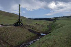 Drill rig 05. Mobile drill rig in green field exploration in Mongolia Stock Image