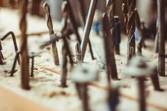 The drill is sawdust. The drill is in the sawdust, among other tools Royalty Free Stock Photography