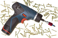 Drill-screwdriver electric storage and screws Stock Photography