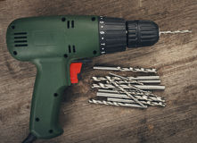 Drill and set of drill bits Royalty Free Stock Photos