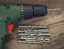 Drill and set of drill bits stock images
