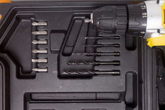 Drill and set of drill bits Stock Image