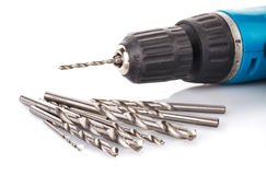 Drill and set of drill bits on white Stock Image