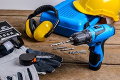 Drill and set of drill,tools,carpenter and safety, Protection Eq Royalty Free Stock Image