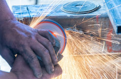 Drill sharpening with grindstone abrasive disc cutter machine Royalty Free Stock Image