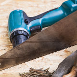 Drill with timber, screwdrivers and screws Royalty Free Stock Photography