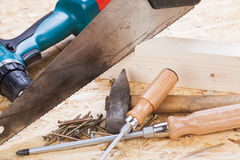 Drill with timber, screwdrivers and screws Stock Photo