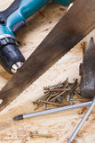 Drill with timber, screwdrivers and screws Royalty Free Stock Photo