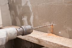 Drill the wall Stock Photo