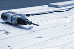 Drill on wood. Drill and bit on wood at construction site Royalty Free Stock Photo