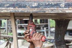 Drill on wood Stock Photos