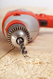 Drill on wooden surface Stock Images