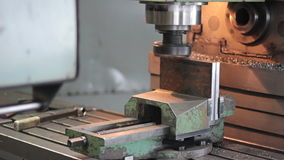 Drill is working to steel part, polishes stock video