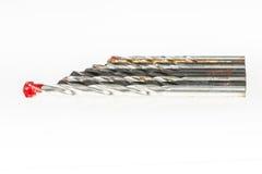 Drillbits no fundo branco fotografia de stock royalty free