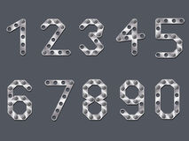 Drilled metallic numbers. Design on dark background Stock Photography