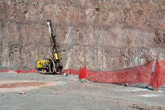 Driller in an open pit mine Stock Photo