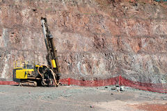 Driller in an open pit mine Royalty Free Stock Image