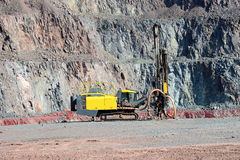 Driller in an open pit mine Stock Photography