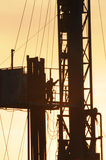 Drilling 024. A detail view of an oil drilling station at sunset Stock Image