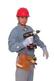 Drilling. Young carpenter holding a drill Stock Image