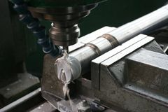 Drilling. Metal in factory workshop Stock Photo