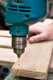 Drilling the board Stock Image