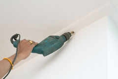 Drilling a ceiling with electric drill Stock Photography