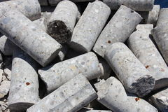 Drilling cores. Multiple cores of concrete lying on a heap royalty free stock photo