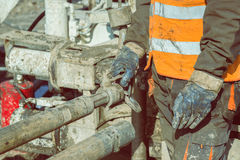 Drilling crewmen hands connect drill pipe 4 Stock Images