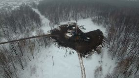 Drilling a deep well with a drilling rig in an oil and gas field in winter forest. The field is located in Kamchatka