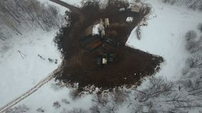 Drilling a deep well with a drilling rig in an oil and gas field in winter forest. Field is located in Kamchatka, Tundra