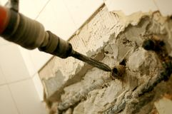 Drilling and demolition. Reconstruction of flat, arrangement of an apartment , reconstruction concept , breaker hammer in use Stock Images