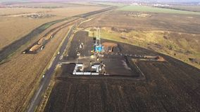 Drilling derrick on the gas field. Aerial filming. Drilling derrick. Natural gas field. Quadcopter shooting, flies away from a tower. Ukraine, Kharkiv region stock footage