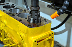 Drilling of an engine block Royalty Free Stock Images