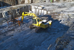 Drilling equipment in a stone quarry. The quarry is located on Ystehede in Halden municipality. Norway. In the quarry the stones are broken for building and Royalty Free Stock Photography