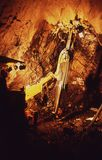 Drilling equipment in an underground mine shaft. Reinfroccing the roof of the mine royalty free stock images