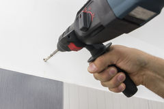 Drilling hole in bathroom wall 2 Stock Photos