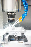 Drilling hole or boring detail with lubricant liquid coolant Stock Photo