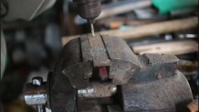 Drilling a hole into iron stock footage