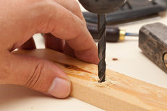 Drilling a hole into wood Royalty Free Stock Photo
