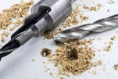 Drilling holes in chipboard. Joinery accessories used in the con stock images
