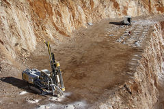 Drilling holes for demolition in a quarry Royalty Free Stock Image