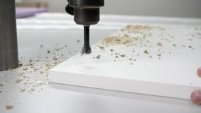 Drilling holes in details. A worker makes a hole in a wooden part using a drilling machine stock video