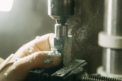 Drilling holes on wood parts. stock image